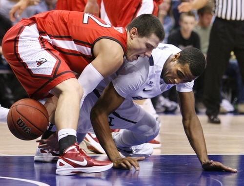 Steve Griffin  |  The Salt Lake Tribune   BYU's Brandon Davies, right, and BYU-Hawaii's Jake Dastrup battle for the ball during first half action in the BYU versus BYU Hawaii basketball game at the Marriott Center in Provo, Utah Tuesday, November 15, 2011.