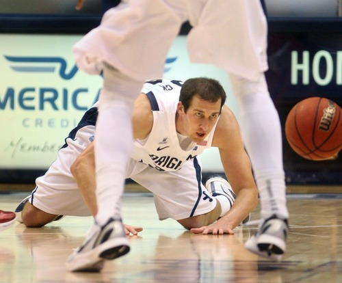 Steve Griffin  |  The Salt Lake Tribune   BYU's Noah Hartsock scrambles for a loose ball during first half action in the BYU versus BYU Hawaii basketball game at the Marriott Center in Provo, Utah Tuesday, November 15, 2011.