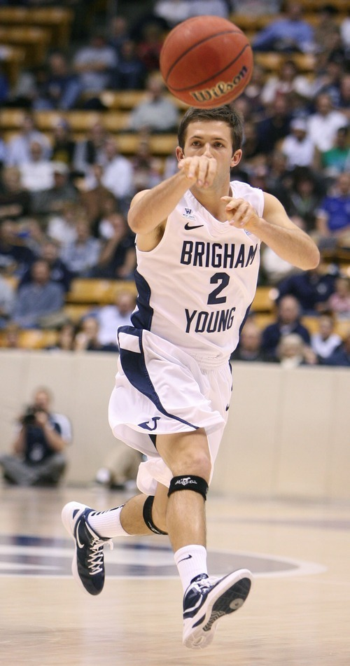 Steve Griffin  |  The Salt Lake Tribune   BYU's Craig Cusick fires a pass up court during first half action in the BYU versus BYU Hawaii basketball game at the Marriott Center in Provo, Utah Tuesday, November 15, 2011.