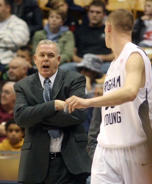 Steve Griffin  |  The Salt Lake Tribune   BYU head coach Dave Rose gives instructions to Nate Austin as he enters the game during first half action in the BYU versus BYU Hawaii basketball game at the Marriott Center in Provo, Utah Tuesday, November 15, 2011.