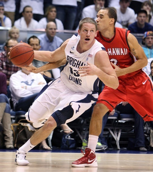 Steve Griffin  |  The Salt Lake Tribune   BYU's Brock Zystra drives around BYU-Hawaii's Gary Satterwhite during first half action in the BYU versus BYU Hawaii basketball game at the Marriott Center in Provo, Utah Tuesday, November 15, 2011.