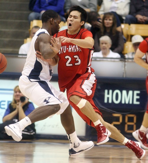 Steve Griffin  |  The Salt Lake Tribune   BYU-Hawaii's Jet Chang, right, crashes into BYU's Charles Abouo during first half action in the BYU versus BYU Hawaii basketball game at the Marriott Center in Provo, Utah Tuesday, November 15, 2011.