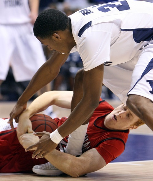 Steve Griffin  |  The Salt Lake Tribune   BYU's Damarcus Harrison, top, battles Christian Covey, of BYU-Hawaii during first half action in the BYU versus BYU Hawaii basketball game at the Marriott Center in Provo, Utah Tuesday, November 15, 2011.