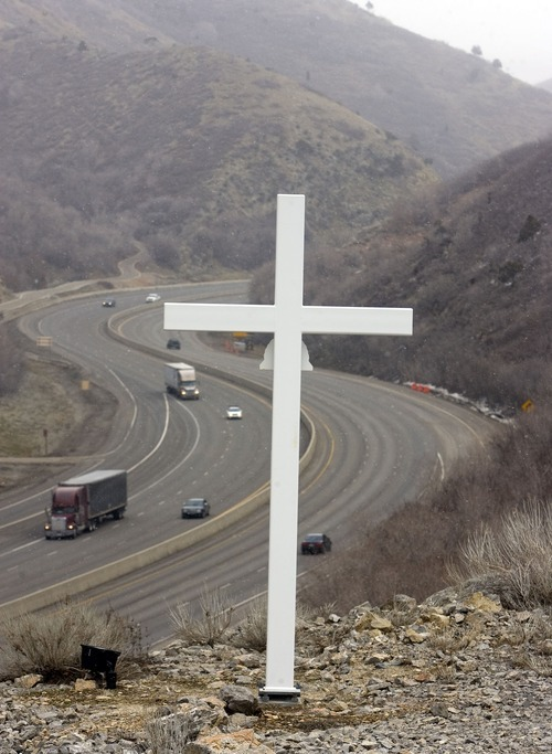 Tribune file photo A cross along Interstate 80 in Parleys Canyon memorializes Trooper Dan Harris, who died there in 1982 while chasing a speeder