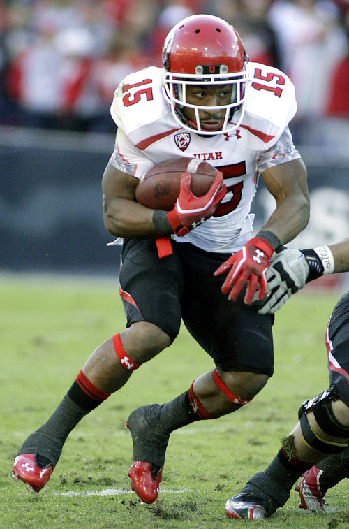 Utah's John White (15) looks for an opening to run though against Arizona during the first half of an NCAA college football game in Tucson, Ariz., Saturday, Nov. 5, 2011. (AP Photo/John Miller)