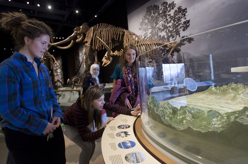Al Hartmann  |  The Salt Lake Tribune University of Utah geology students Katie Bradbury, left, Glinis Jehle and Daniela Anguita check out an interactive model of the Salt Lake Valley in which one can raise or lower water levels from different time periods of Lake Bonneville during the opening day of the Natural History Museum of Utah.