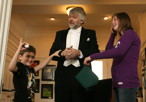 Leah Hogsten  |  The Salt Lake Tribune Richard Hatch entertains Charlie Viator and Hailey Burns (right) during the
