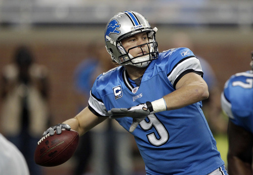 Detroit Lions quarterback Matthew Stafford (9) throws during the first quarter of an NFL football game against the Carolina Panthers in Detroit, Sunday, Nov. 20, 2011. (AP Photo/Carlos Osorio)