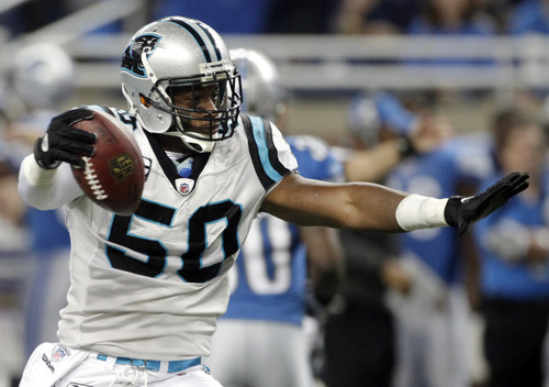 Carolina Panthers outside linebacker James Anderson (50) reacts after an interception during the first quarter of an NFL football game against the Detroit Lions in Detroit, Sunday, Nov. 20, 2011. (AP Photo/Duane Burleson)