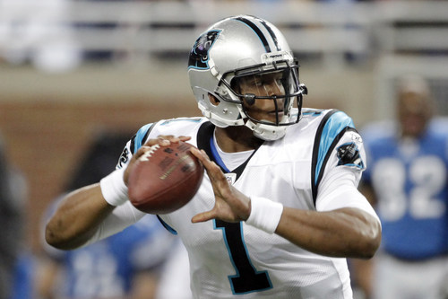 Carolina Panthers quarterback Cam Newton (1) throws during the first quarter of an NFL football game against the Detroit Lions in Detroit, Sunday, Nov. 20, 2011. (AP Photo/Duane Burleson)