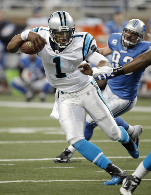 Carolina Panthers quarterback Cam Newton (1) carries the ball against the Detroit Lions in the first quarter of an NFL football game Sunday, Nov. 20, 2011, in Detroit. (AP Photo/Duane Burleson)