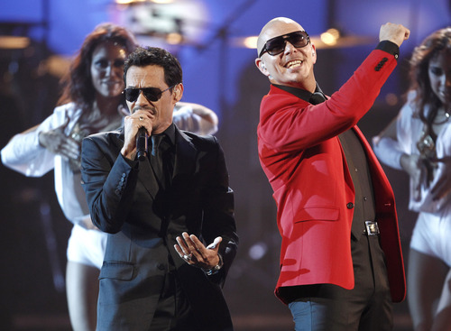 Marc Anthony, left, and Pitbull perform at the 39th Annual American Music Awards on Sunday, Nov. 20, 2011 in Los Angeles. (AP Photo/Matt Sayles)