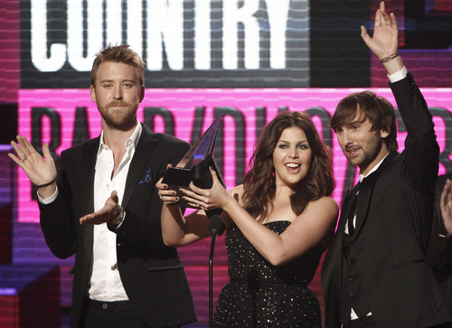 Lady Antebellum accepts the award for country band, duo or group at the 39th Annual American Music Awards on Sunday, Nov. 20, 2011 in Los Angeles. From left, Charles Kelley, Hillary Scott and Dave Haywood. (AP Photo/Matt Sayles)