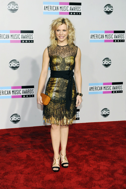 Kimberly Perry from The Band Perry arrives at the 39th Annual American Music Awards on Sunday, Nov. 20, 2011 in Los Angeles. (AP Photo/Chris Pizzello)