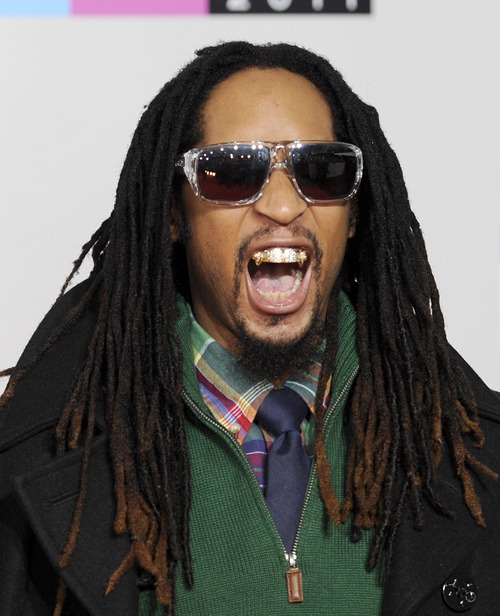 Lil Jon arrives at the 39th Annual American Music Awards on Sunday, Nov. 20, 2011 in Los Angeles. (AP Photo/Chris Pizzello)