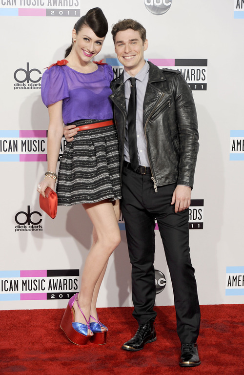 Amy Heidemann, left, and Nick Noonan, of the musical group Karmin, arrive at the 39th Annual American Music Awards on Sunday, Nov. 20, 2011 in Los Angeles. (AP Photo/Chris Pizzello)