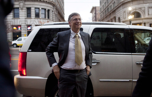 Microsoft founder Bill Gates arrives at the Frank E. Moss federal courthouse in Salt Lake City, Monday, Nov.  21, 2011. Gates was scheduled to testify in a one billion dollar antitrust lawsuit brought by Novell Inc. Gates, wearing a gray suit and a yellow tie, was the first witness to testify as Microsoft lawyers presented their case in the trial that's been ongoing in federal court in Salt Lake City for about a month.(AP Photo/Jim Urquhart)