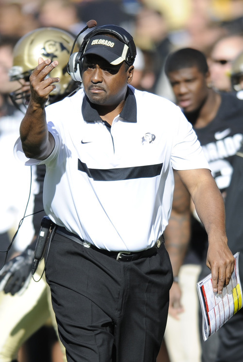 FILE - In this Nov. 12, 2011 file photo, Colorado head coach Jon Embree motions for a referee during the first half of an NCAA college football game against Arizona, in Boulder, Colo.  Colorado coach Embree is proud of his son's career even while he's scheming ways to ruin Taylor's final game at the Rose Bowl. (AP Photo/Jack Dempsey, File)