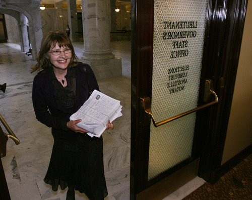Scott Sommerdorf  |  Tribune File Photo              Catherine Martone of Americans Elect delivers a petition with 4,000 signatures to the Lieutenant Governor's Office last month seeking to get on the presidential ballot. The group, which was certified for the ballot Wednesday, will allow people to pick a nominee through online voting.