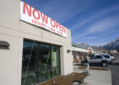 Al Hartmann  |  The Salt Lake Tribune The liquor store at 1863 E. Fort Union Blvd., Cottonwood Heights, the state's busiest liquor outlet, has reopened. The store was closed for remodeling in July and was scheduled to reopen in October until asbestos was discovered underneath the flooring.