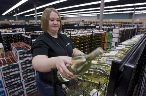 Al Hartmann  |  The Salt Lake Tribune Store clerk Sami Stone stocks wine racks at the newly reopened liquor store at 1863 E. Fort Union Blvd. The liquor store, which is the state's busiest, rang up sales of $16 million last year.