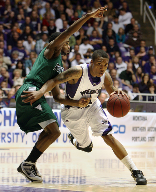 Steve Griffin  |  The Salt Lake Tribune  Ogden -  Weber State's Damian Lillard drives past Portland State's Melvin Jones  during semifinal game of the Big Sky Tournament at the Dee Events Center in Ogden between Weber State and Portland State Tuesday Mar 9, 2010.