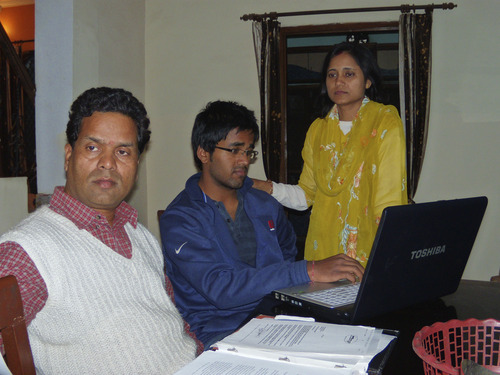 Courtesy photo After visiting the U.S. Embassy in Delhi, Ken, Kunal and Sarita Sah look over immigration papers. Ken and Sarita were forced to leave the U.S. in 2006 but own two motels in Green River, Utah. They are trying to find a way to return.