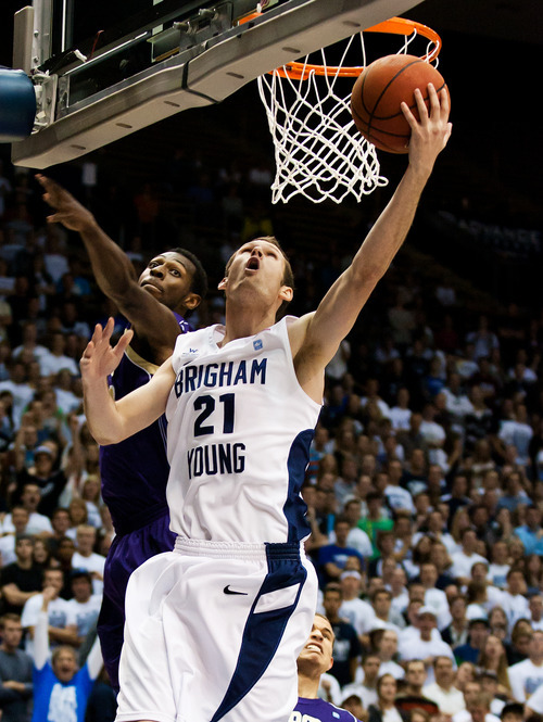 BYU's Stephen Rogers makes a layup against Prairie View A&M  during an NCAA college basketball game at the Marriott Center in Provo, Utah, on Tuesday, Nov. 22, 2011. (AP Photo/The Daily Herald, Spenser Heaps)