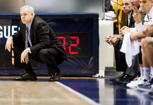 BYU head coach Dave Rose watches the action against Prairie View A&M  during an NCAA college basketball game at the Marriott Center in Provo, Utah, on Tuesday, Nov. 22, 2011. (AP Photo/The Daily Herald, Spenser Heaps)