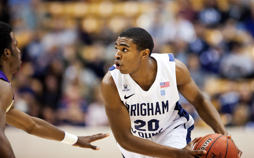BYU's Anson Winder works the ball against Prairie View A&M  during an NCAA college basketball game at the Marriott Center in Provo, Utah, on Tuesday, Nov. 22, 2011. (AP Photo/The Daily Herald, Spenser Heaps)