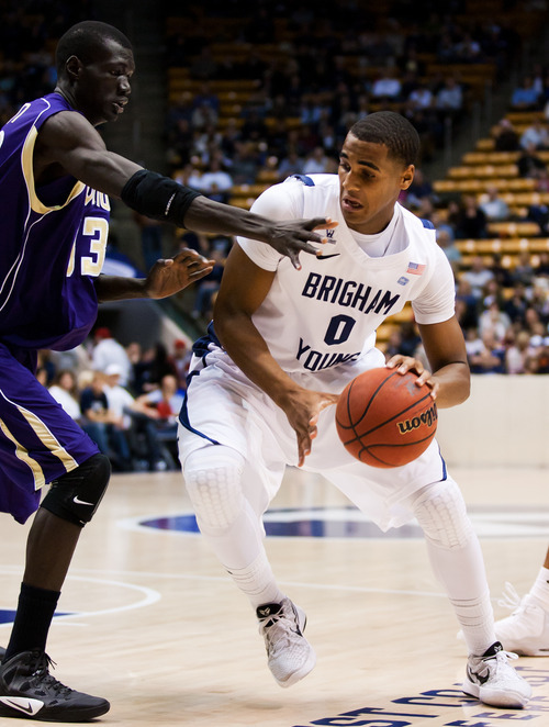 BYU's Brandon Davies works the ball against Prairie View A&M's Mayol Riathin during an NCAA college basketball game at the Marriott Center in Provo, Utah, on Tuesday, Nov. 22, 2011. (AP Photo/The Daily Herald, Spenser Heaps)