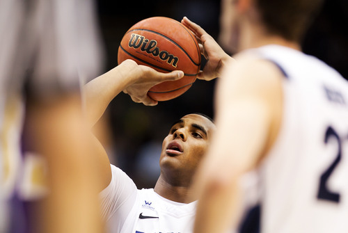 BYU's Brandon Davies attempts a free throw against Prairie View A&M  during an NCAA college basketball game at the Marriott Center in Provo, Utah, on Tuesday, Nov. 22, 2011. (AP Photo/The Daily Herald, Spenser Heaps)