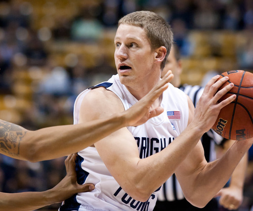 BYU's Brock Zylstra looks for an open teammate against Prairie View A&M  during an NCAA college basketball game at the Marriott Center in Provo, Utah, on Tuesday, Nov. 22, 2011. (AP Photo/The Daily Herald, Spenser Heaps)