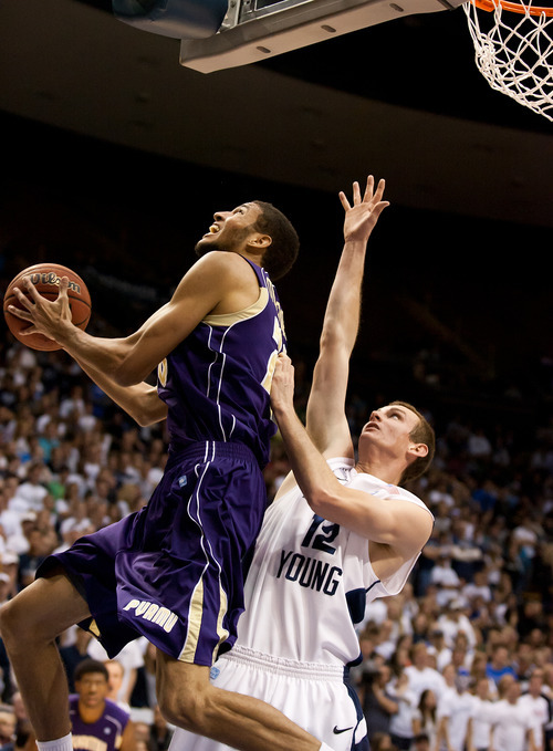 Prairie View A&M's Jules Montgomery goes in for a layup as BYU's Josh Sharp defends during an NCAA college basketball game at the Marriott Center in Provo, Utah, on Tuesday, Nov. 22, 2011. (AP Photo/The Daily Herald, Spenser Heaps)