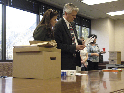 Donald W. Meyers | The Salt Lake Tribune  Provo City Recorder Janene Weiss and Chief Deputy Utah County Clerk-Auditor Scott Hogensen demonstrate the process for a hand-count that will be used to recount ballots in the Provo Municipal Council District 1 race Wednesday. County election officials opted for a manual recount after optical scanners showed discrepancies in the results between Gary Winterton and Bonnie Morrow.