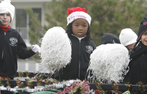 Rick Egan  | The Salt Lake Tribune   Members of the Starite Dance Academy ride on a float, during the West Valley Christmas Parade, Friday, November 25, 2011.