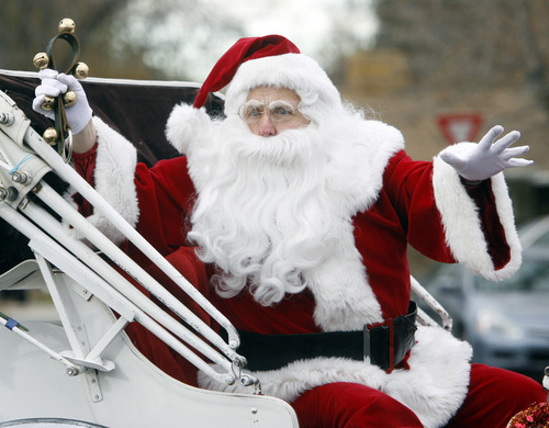 Rick Egan  | The Salt Lake Tribune   Santa Claus waves to the crowd from his sleigh, in the West Valley Christmas Parade, Friday, November 25, 2011.