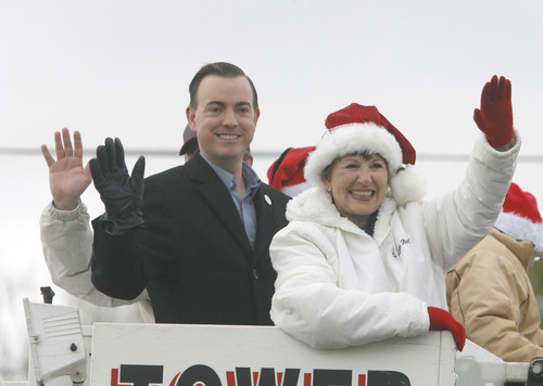 Rick Egan  | The Salt Lake Tribune   West Valley Mayor Mike Winder and councilmember, Carolynn Burt, wave to the crowd as they ride on a fire truck during the West Valley Christmas Parade, Friday, November 25, 2011.