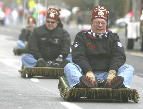 Rick Egan  | The Salt Lake Tribune   El Kalah Shriners ride their motorized magic carpets in the West Valley Christmas Parade, Friday, November 25, 2011.