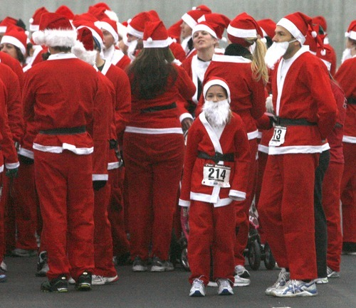 Rick Egan  | The Salt Lake Tribune  Eight-year-old Michelle Filipouvic  (214) prepares for Santa Run 5K at Valley Fair Mall on Friday.