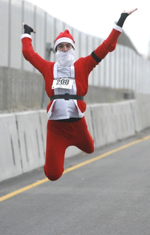 Rick Egan  | The Salt Lake Tribune   Clark Ripplinger, of South Jordan, leaps for joy during Santa Run 5K at Valley Fair Mall on Friday.