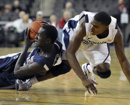 Nevada's Patrick Nyeko left, tries to keep the ball away from Brigham Young's Anson Winder during the first half of an NCAA college basketball game, Friday, Nov. 25, 2011, in Hoffman Estates, Ill. (AP Photo/Jim Prisching)