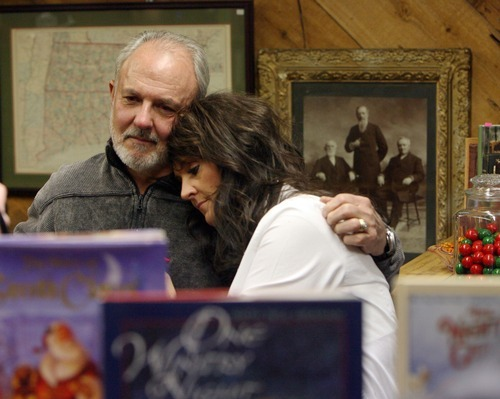Steve Griffin  |  The Salt Lake Tribune  Earl Black hugs his daughter Heidi Miller at the B&W Billiards and Books store in Salt Lake City on Monday, Nov. 28, 2011, on the anniversary of Sherry Black's murder in the bookstore. Sherry was Heidi's mother and Earl's wife. The father and daughter will host a memorial service Wednesday, Nov. 30, 2011 at Wasatch Lawn Memorial Park and Mortuary.