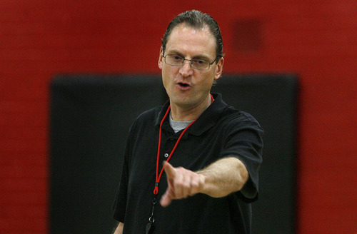 Scott Sommerdorf  |  The Salt Lake Tribune              West boys basketball coach Mike Matheson runs practice at West Monday, November 28, 2011.