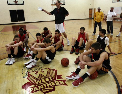 Scott Sommerdorf  |  The Salt Lake Tribune              West boys basketball coach Mike Matheson talks with his team after  practice at West Monday, November 28, 2011.