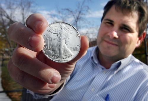 Steve Griffin  |  The Salt Lake Tribune Carlton Bowen with a Silver Eagle coin like the ones he attempted to use to pay his state and county taxes. He was refused by government agencies who say they aren't equipped to accept such payment.