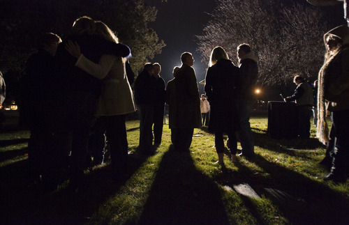 Steve Griffin  |  The Salt Lake Tribune  People gather around the gravesite of Sherry Black during memorial service for Black who was murdered in her bookstore in Salt Lake City, Utah. The memorial was held at Wasatch Lawn Memorial Park & Mortuary Wednesday, November 30, 2011.
