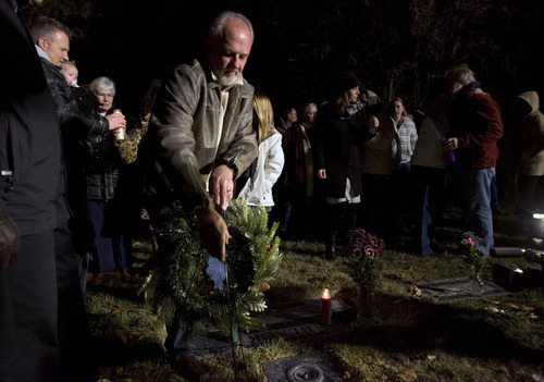 Steve Griffin  |  The Salt Lake Tribune  Earl Black places a wreath at the gravesite of his wife Sherry Black during memorial services at Wasatch Lawn Memorial Park & Mortuary Wednesday, November 30, 2011. Black was murdered in her bookstore for in Salt Lake City, Utah last year.