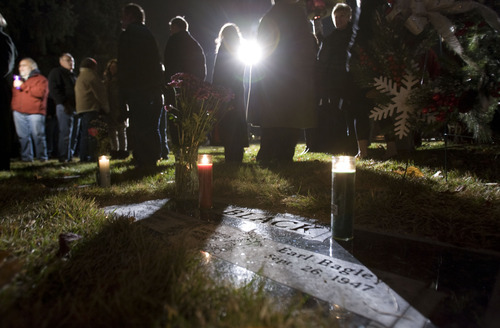 Steve Griffin  |  The Salt Lake Tribune  People gather around the gravesite of Sherry Black during memorial service for Black who was murdered in her bookstore in Salt Lake City, Utah last year.  The memorial was held at Wasatch Lawn Memorial Park & Mortuary Wednesday, November 30, 2011.