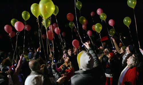 Steve Griffin  |  The Salt Lake Tribune  Balloons are released at the gravesite of Sherry Black during memorial service for Black who was murdered in her bookstore in Salt Lake City, Utah last year.  The memorial was held at Wasatch Lawn Memorial Park & Mortuary Wednesday, November 30, 2011.